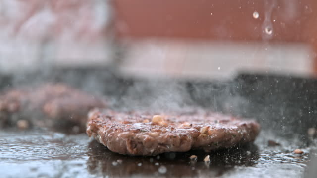 slo mo flipping a burger - burgers stock videos and b-roll footage