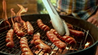 istock SLO MO Flipping hot dogs while grilling 606087304