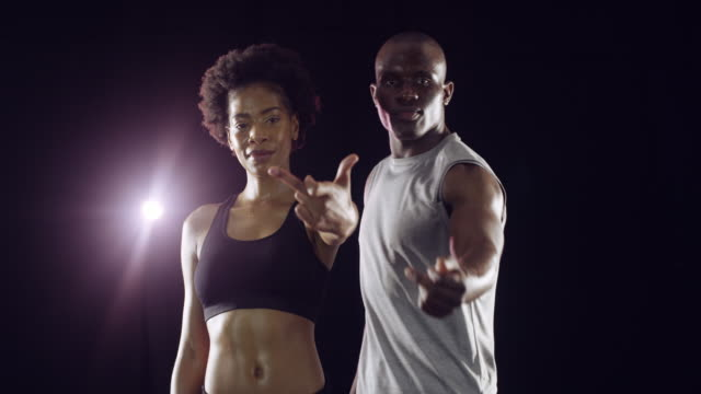 Flipping you the bird 4k video footage of two athletic young people against a black background middle finger stock videos & royalty-free footage