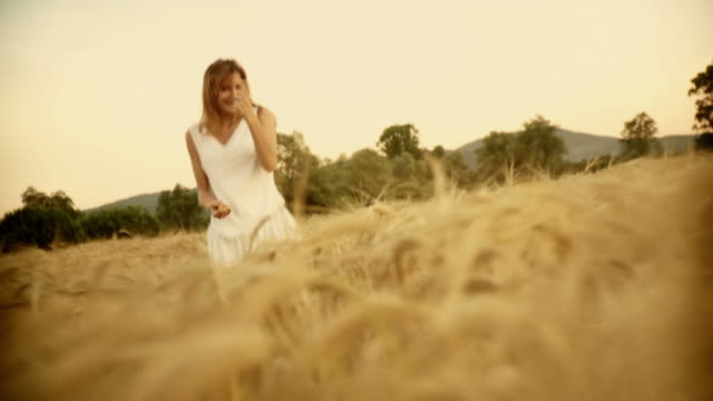 HD SLOW-MOTION: Flirty Woman In Wheat  sepia toned stock videos & royalty-free footage