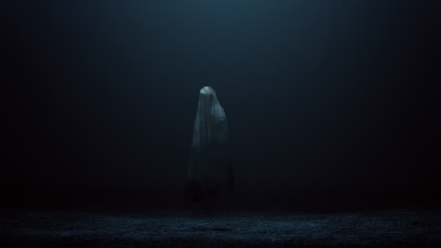 floating evil spirit of a child in a foggy void front - halloween video stock e b–roll
