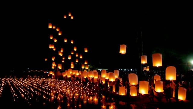floating lantern , yi peng festival , chiangmai thailand - buddha video stock e b–roll