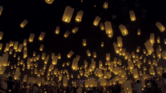 floating lanterns and fireworks yee peng festival, loy kra thong in chiang mai, thailand - sky lantern stock videos and b-roll footage