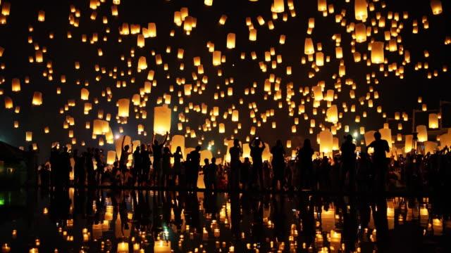 Floating Lanterns in Night Sky. Lanterns floating in night sky at Yi Peng Festival. Chiangmai, Thailand. 4k lantern stock videos & royalty-free footage