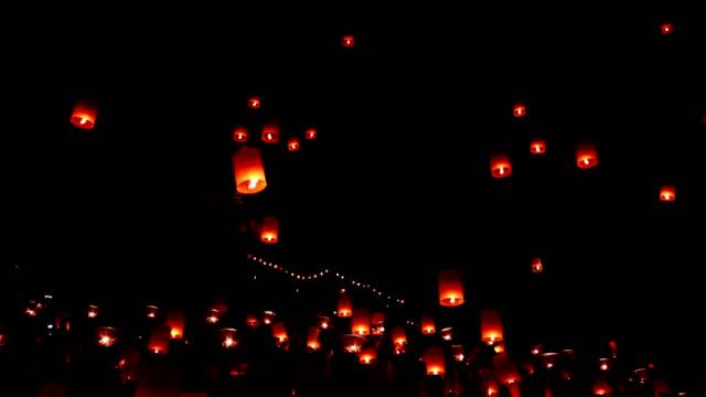 floating lanterns in yee peng festival, loy krathong celebration - sky lantern stock videos and b-roll footage