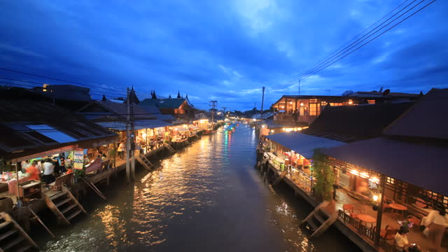 Floating market food at night in the river at Amphawa,