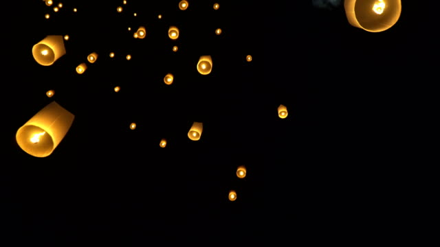 floating new year sky lanterns in chiang mai ,thailand. - sky lantern stock videos and b-roll footage