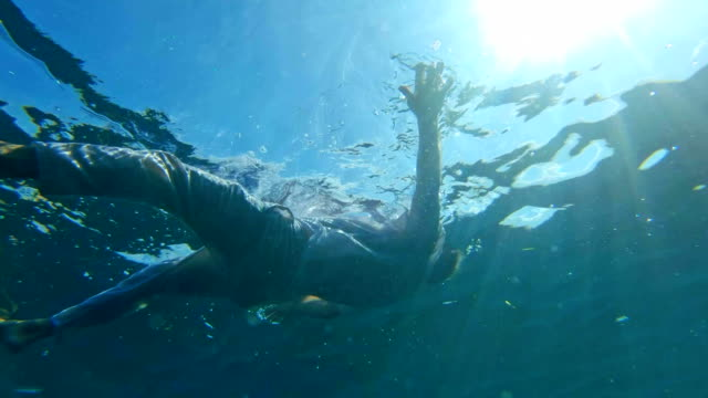 Floating on water. Sea relaxation Underwater shoot. Silhouette floating on water floating on water stock videos & royalty-free footage