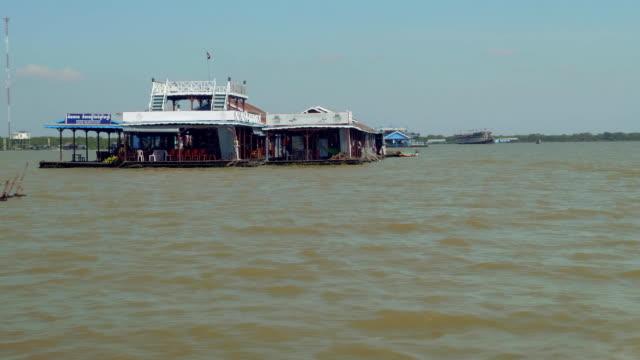 Floating public building on lake Tonle Sap, crocodile farm video