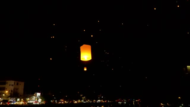 floating sky lanterns at ping river in Chiang Mai ,Thailand video