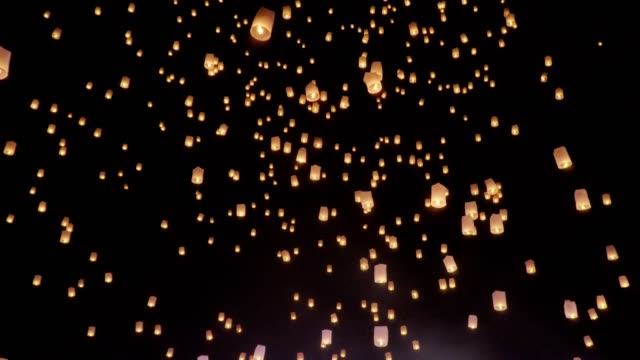 floating sky lanterns in loy krathong festival , chiang mai ,thailand. - sky lantern stock videos and b-roll footage