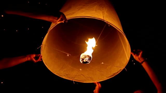 Floating Skylantern 4 SHOTS 4 shots in 1 video on floating sky lantern in Lantern Traditional Festival.  lantern stock videos & royalty-free footage