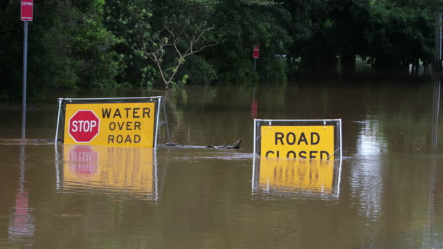 Flood Sign Under Water in the Lismore CBD Flood sign on a road under water near the Lismore, NSW, central business district australia stock videos & royalty-free footage