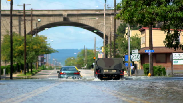 Flooded Car Under Arch Wide Shot with Military Vehicle video