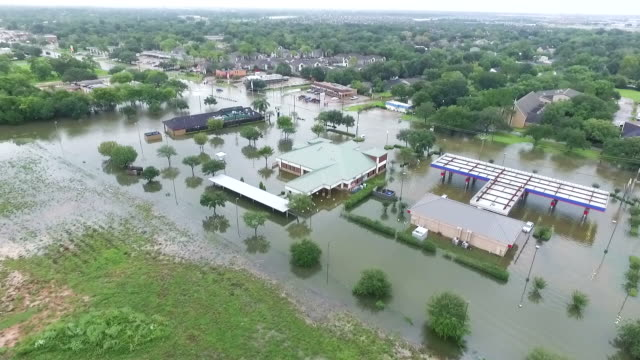 flooded gas station and businesses - uragano video stock e b–roll
