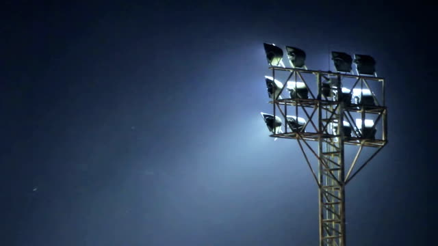 Floodlight : Stock Video Floodlight in the dark with dust. floodlight stock videos & royalty-free footage