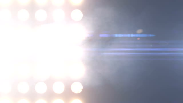 Floodlights flashing Flashing lights on a background for music video electric light stock videos & royalty-free footage