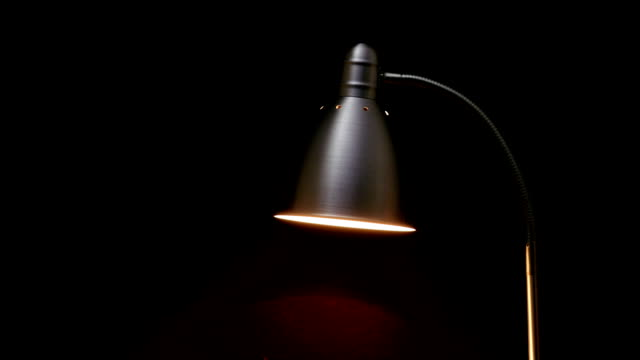 Floor lamp. Real floor lamp turning on, flickering and turning off lamp shade stock videos & royalty-free footage