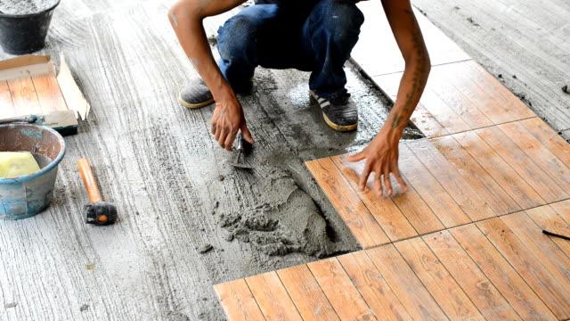 Floor tiling video