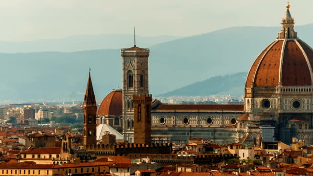 Florence, Tuscany, Italy Slow telephoto panning shot of Florence Old Town, including the Cattedrale di Santa Maria del Fiore, also known as Duomo. Capital of Tuscany, Florence is considered the birthplace of the Renaissance renaissance architecture stock videos & royalty-free footage