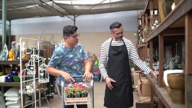 Florist and Customer Buying on Small Business Flower Shop Owner