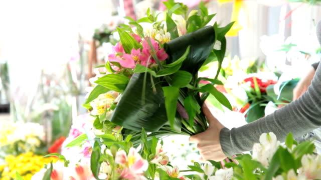 Florist Arranging Bouquet Of Alstroemeria video