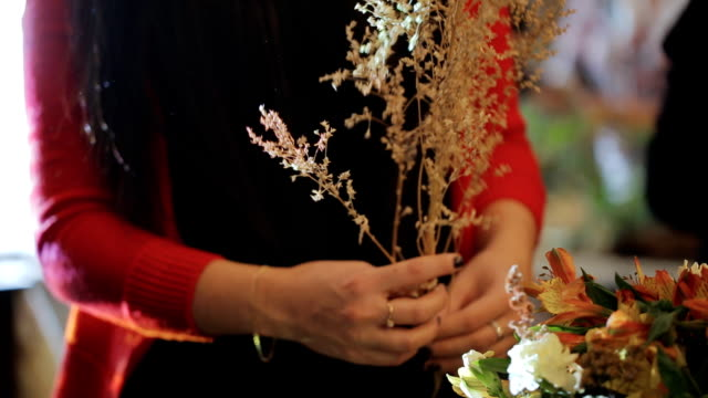 florist at a public event holds one of the components of a great bouquet video