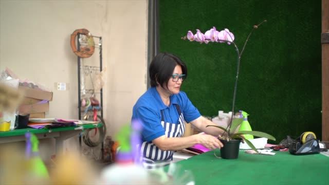 Florist Doing Flowers Arrangements on Small Business Flower Shop Owner
