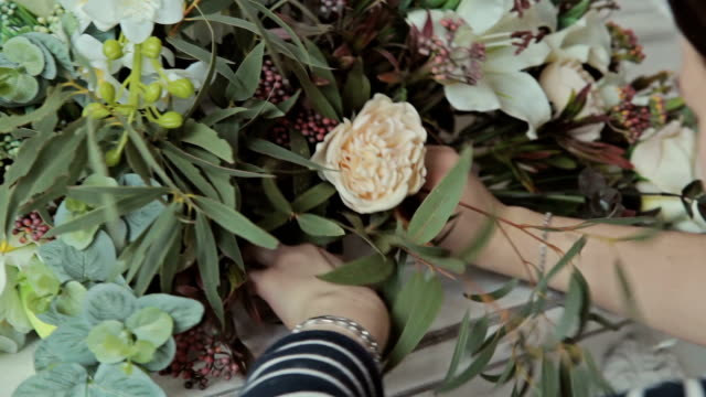 Florist girl making a flower composition video