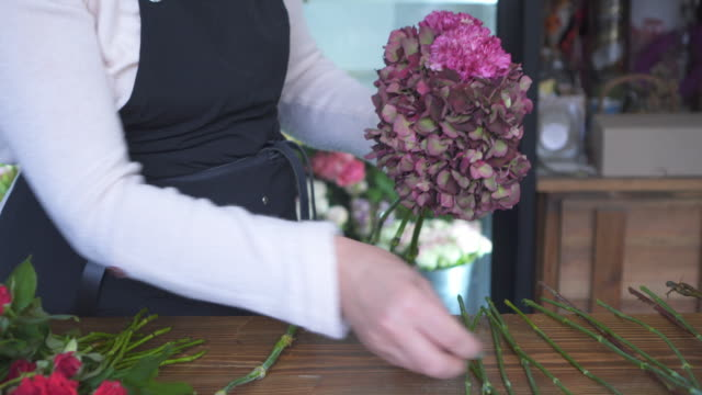 Florist making bouquet at shop