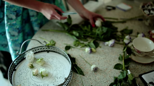 Florist prepares flowers for a floral composition video