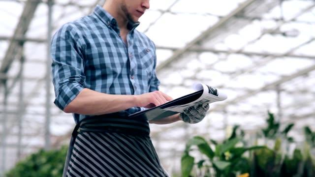 Florist preparing sales order in greenhouse video