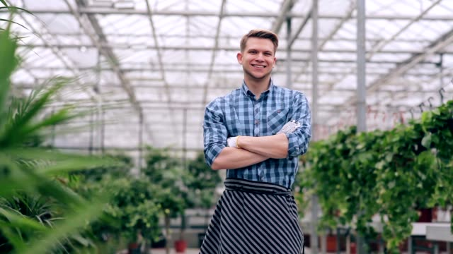 Florist with arms crossed in greenhouse video