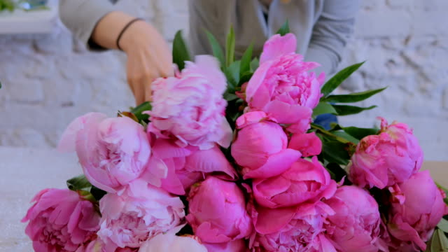 Florist woman making bunch at flower shop video