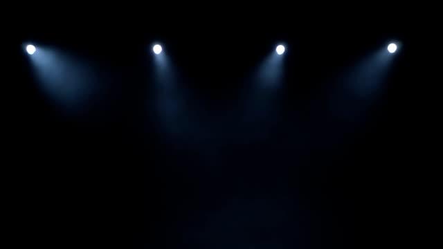 flow of smoke through the light of the laser lights on black background - współzawodnictwo wydarzenia filmów i materiałów b-roll