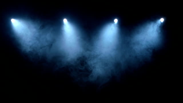 Flow stage of formless smoke swirling against a black background Flow stage of formless smoke swirling against a black background, bright lights illuminate the deserted space electric light stock videos & royalty-free footage