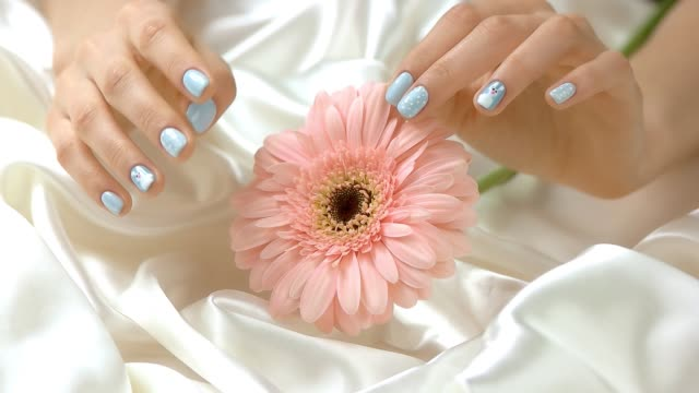 Flower and gentle touches of hand, slow motion. video