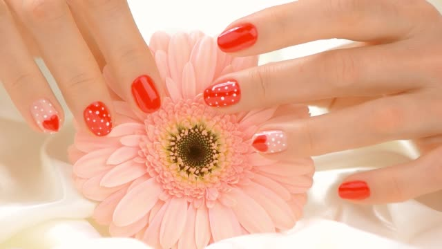 Flower and manicured hands touches, slow motion. video