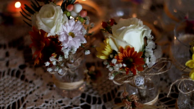 flower decoration on a table at a wedding - триллиум стоковые видео и кадры b-roll