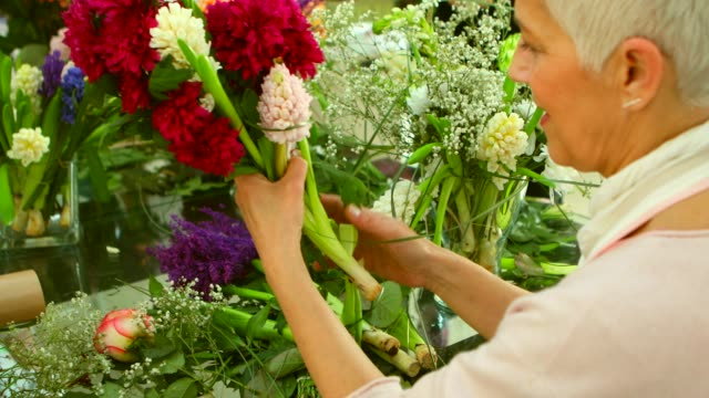 Flower Workshop Learning flower arranging, making beautiful bouquets with your own hands short hair stock videos & royalty-free footage
