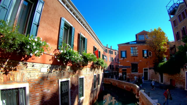 Flowers on the windows in the buildings in Venice Italy video