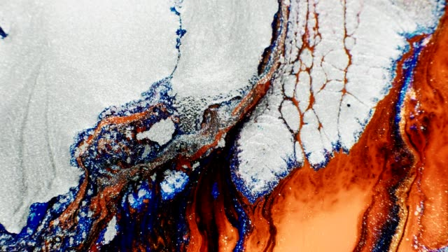 flowing fluid glitter white orange paint motion