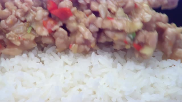 flowing fried pork with basil leaf top on rice - thai food stock videos and b-roll footage