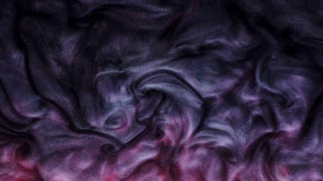 flowing glitter paint texture abstract background - melanzane video stock e b–roll