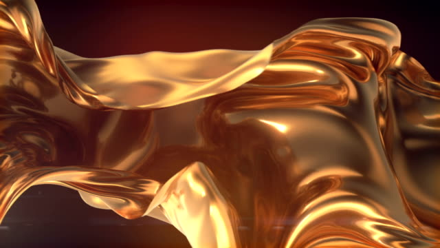 vídeos de stock e filmes b-roll de flowing gold cloth abstract background animation. 3d rendering. 4k uhd - têxtil