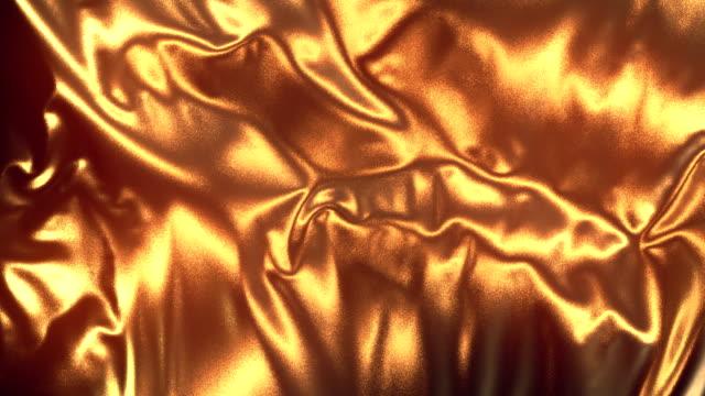 altın bez arka plan animasyon akan. 3d render. 4k uhd - gold texture stok videoları ve detay görüntü çekimi