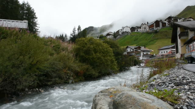 Flowing of water in Stream and Glacier from Alps at Graubunden, Switzerland video