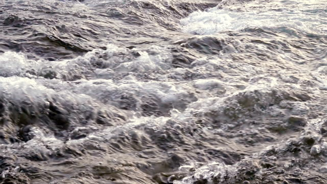 Flowing water in slow motion at sunrise video