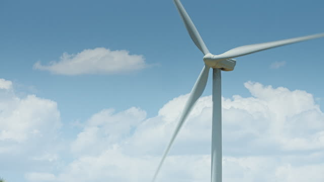 Fluffy Clouds Passing Behind Wind Turbine video