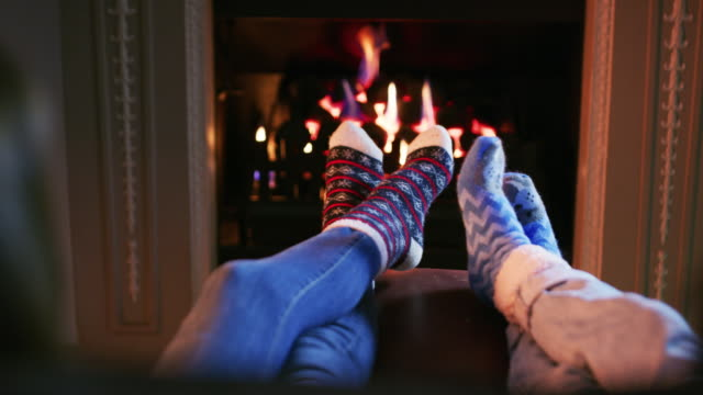 fluffy socks and a fireplace, life's perfect - date night stock videos & royalty-free footage